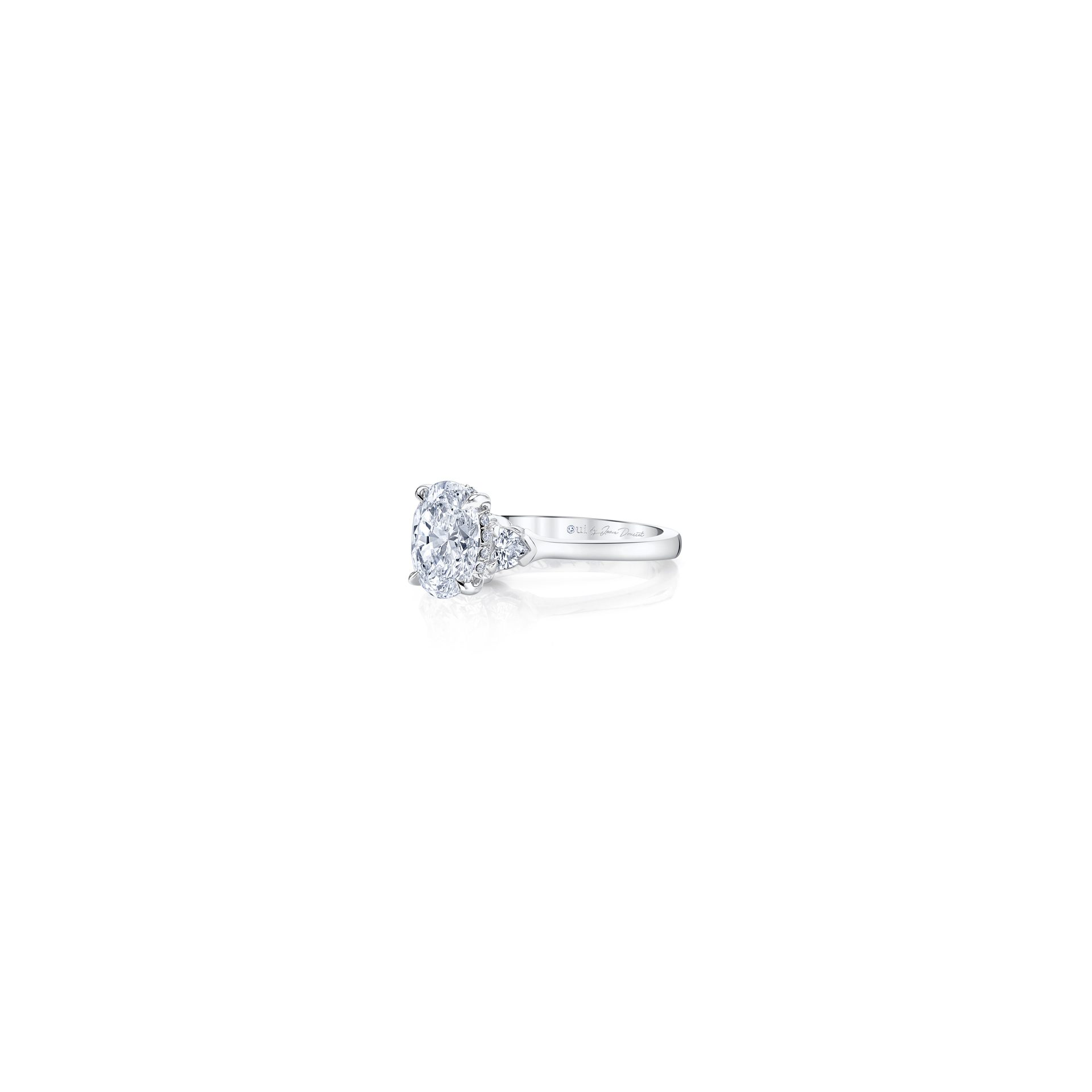 Claire Oval Three Stone Engagement Ring with heart-shaped diamond side stones in 18k White Gold Side View by Oui by Jean Dousset