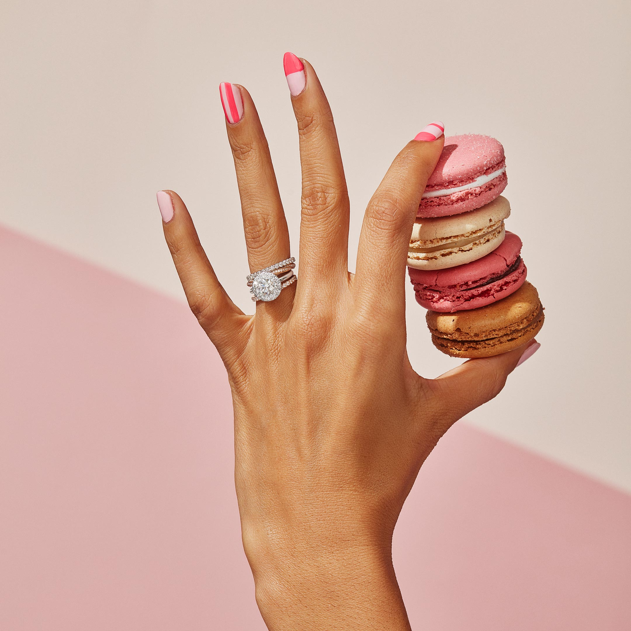 Colette Round Brilliant Seamless Solitaire™ Engagement Ring with a solid band in Platinum Hand with Macaroons Lifestyle by Oui by Jean DoussetColette Round Brilliant Seamless Solitaire™ Engagement Ring with a solid band in Platinum by Oui by Jean Dousset