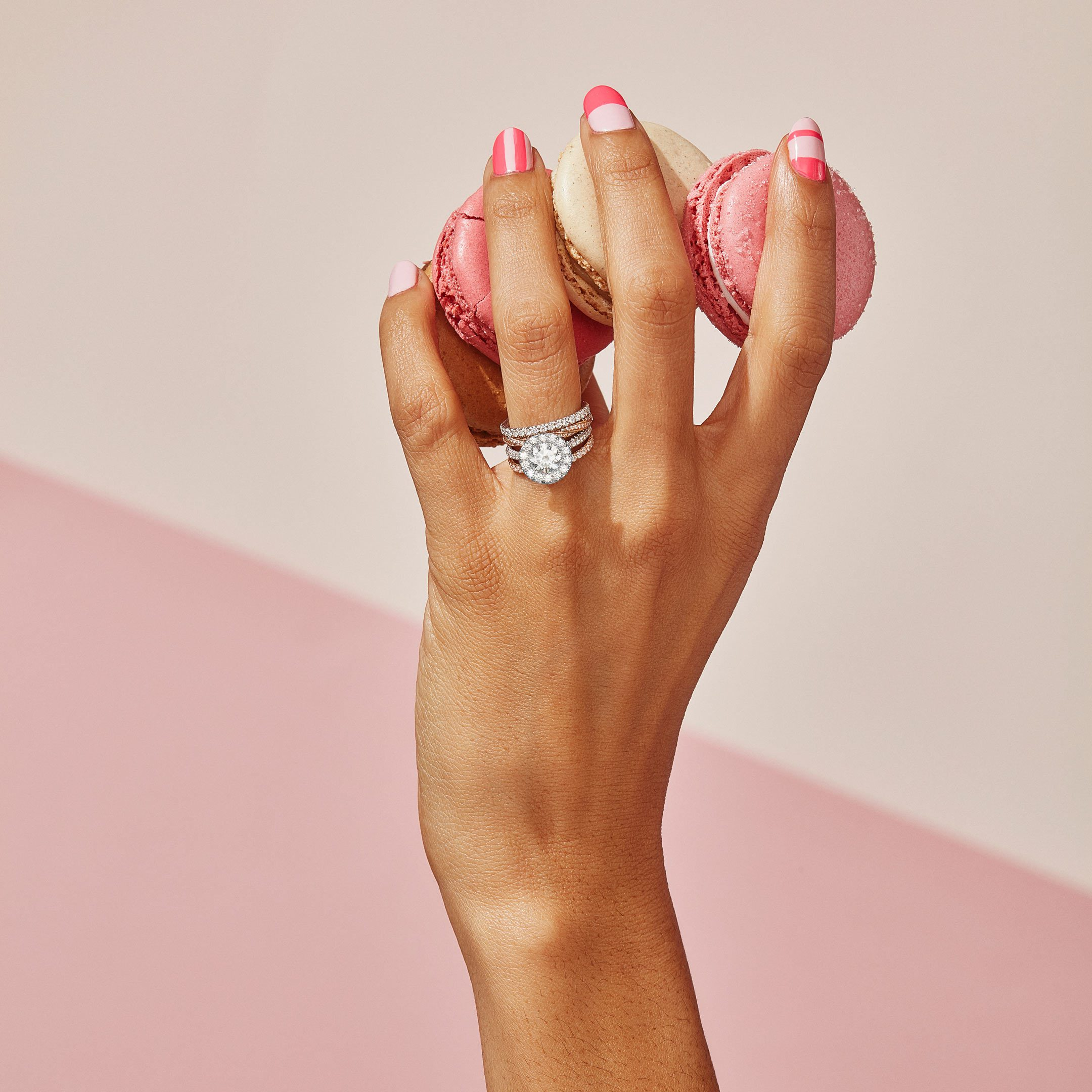 Jacqueline Round Brilliant Seamless Halo® Engagement Ring with diamond pavé in Platinum Hand with Macaroons Lifestyle by Oui by Jean Dousset