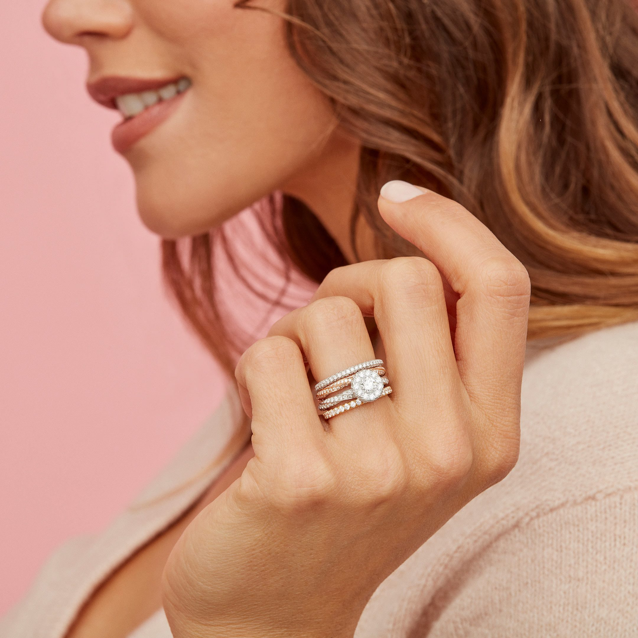 Camille Round Brilliant Seamless Halo® Engagement Ring with a twisted diamond pavé band in Platinum Hand against Model Lifestyle by Oui by Jean Dousset