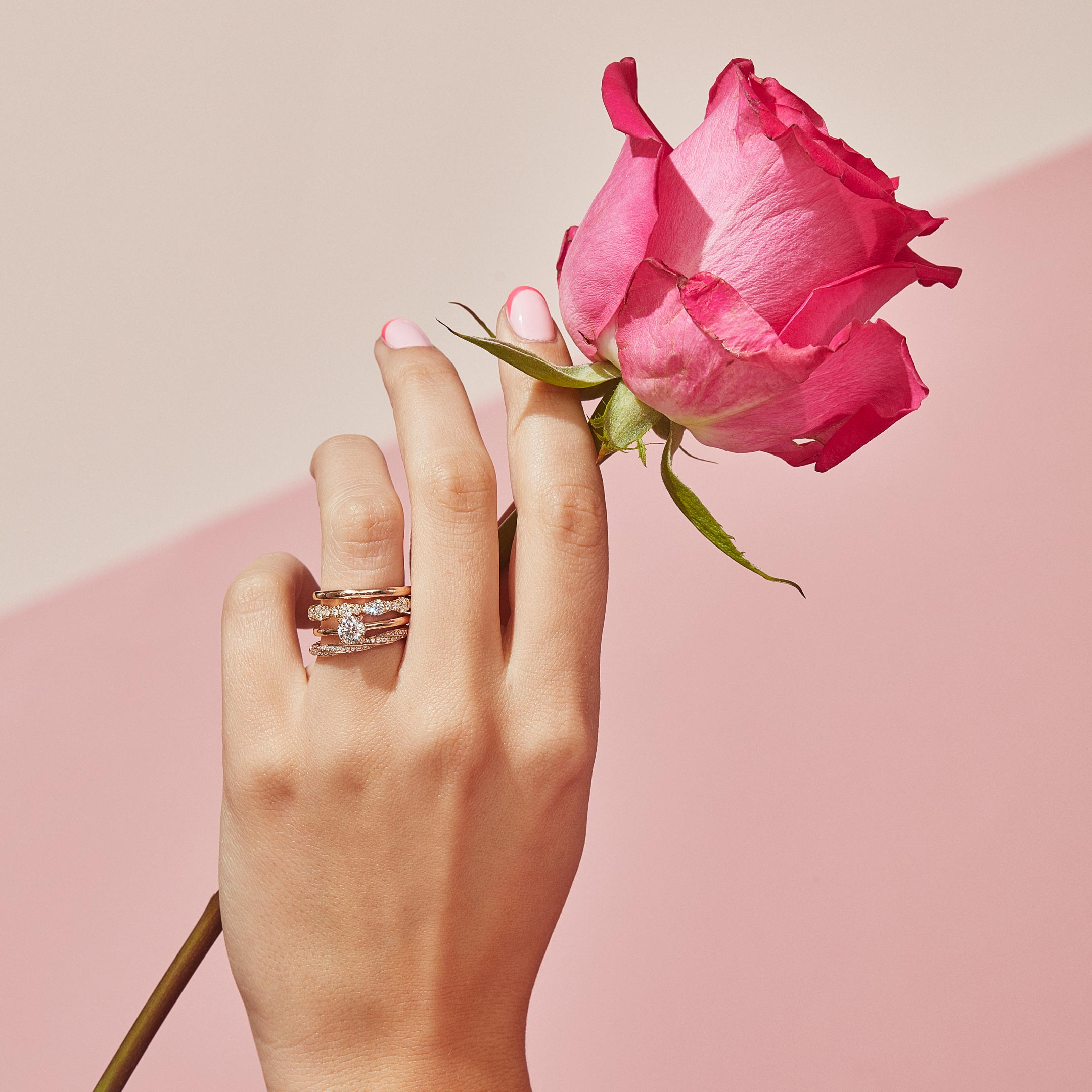 Colette Round Brilliant Solitaire Engagement Ring with a solid band in 18k Rose Gold Hand with Rose Lifestyle by Oui by Jean Dousset