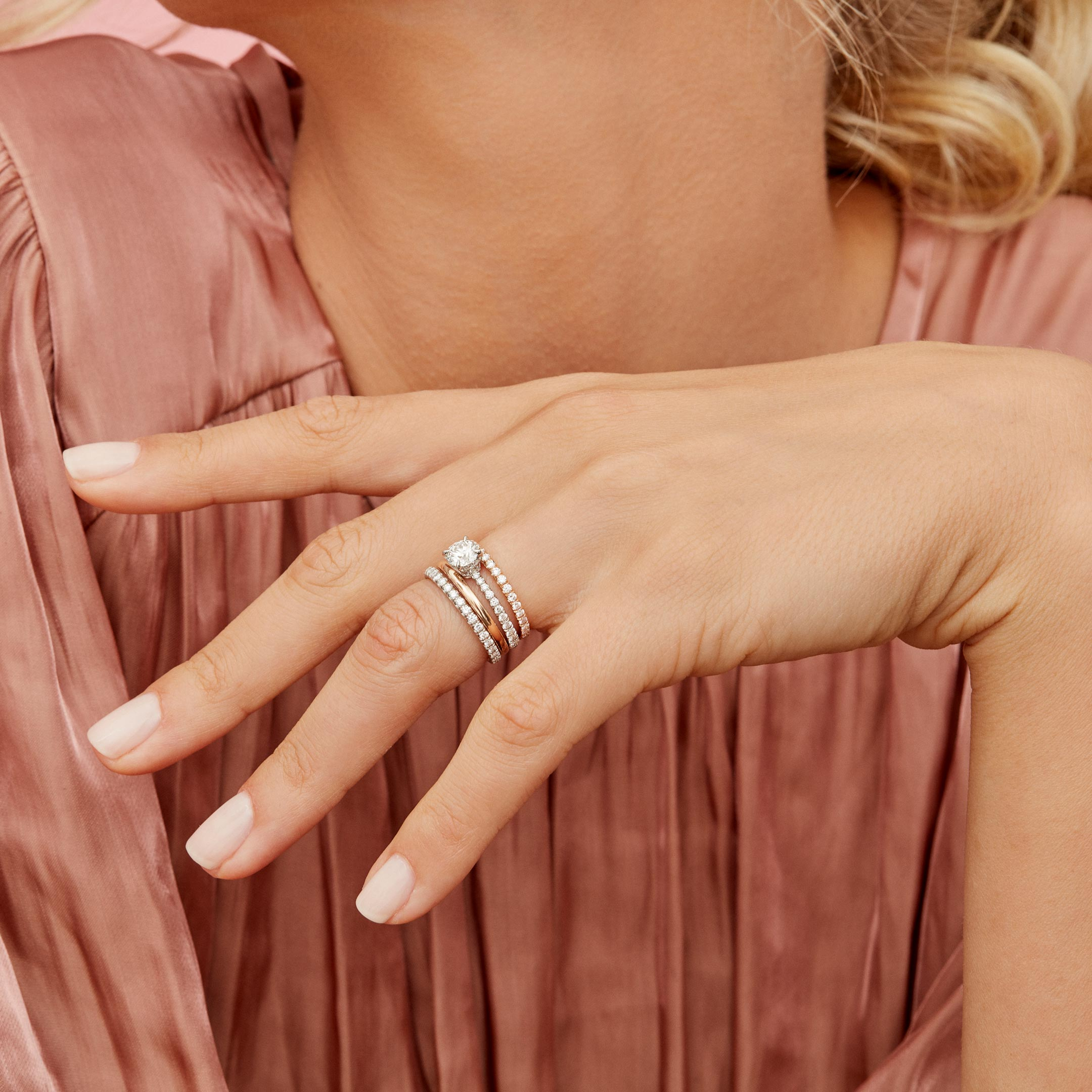 Eloise Round Brilliant Solitaire Engagement Ring with a diamond pavé band in Platinum Hand Against Model Lifestyle by Oui by Jean Dousset