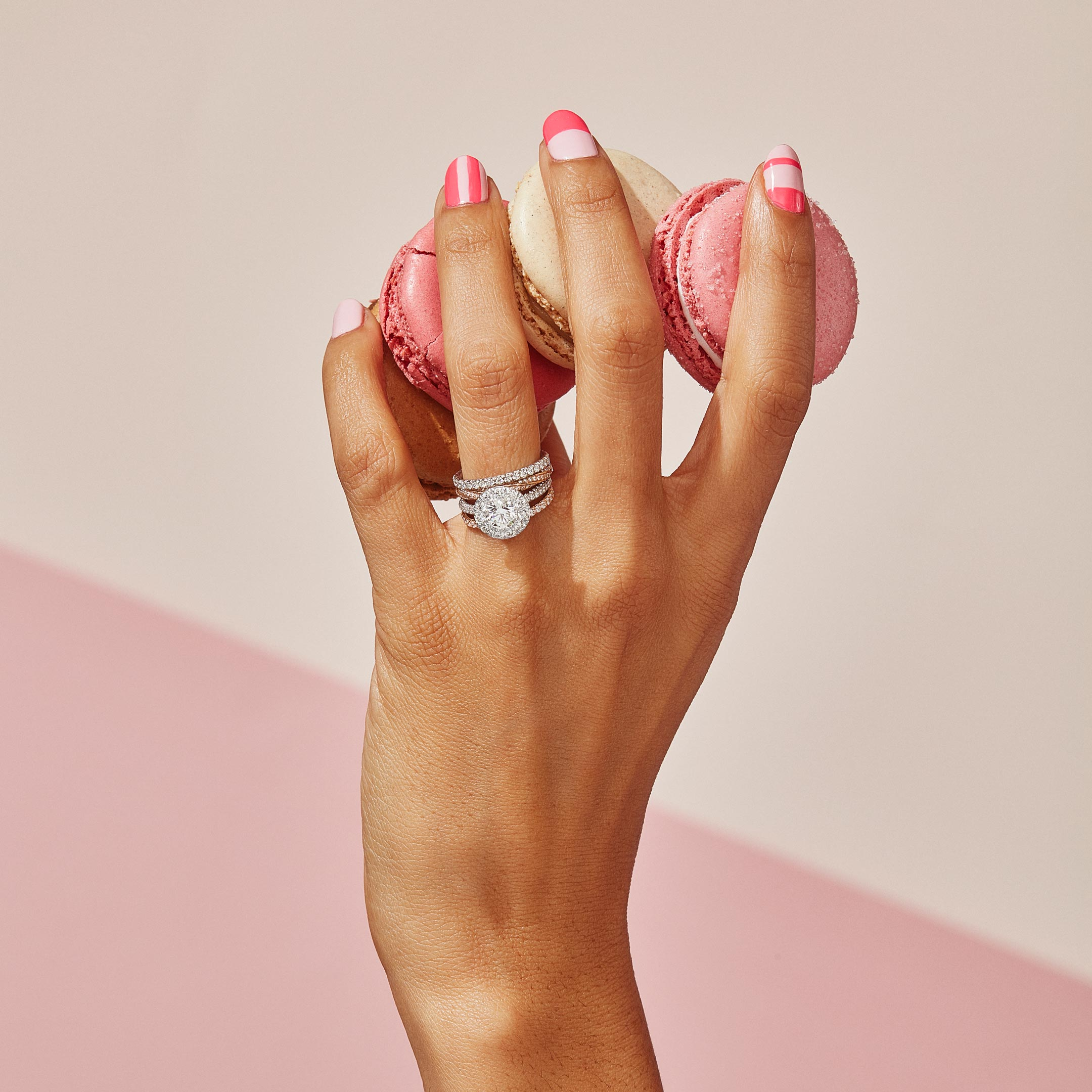 Jacqueline Round Brilliant Seamless Solitaire™ Engagement Ring with a diamond pavé band in Platinum Hands with Macaroons Lifestyle by Oui by Jean Dousset