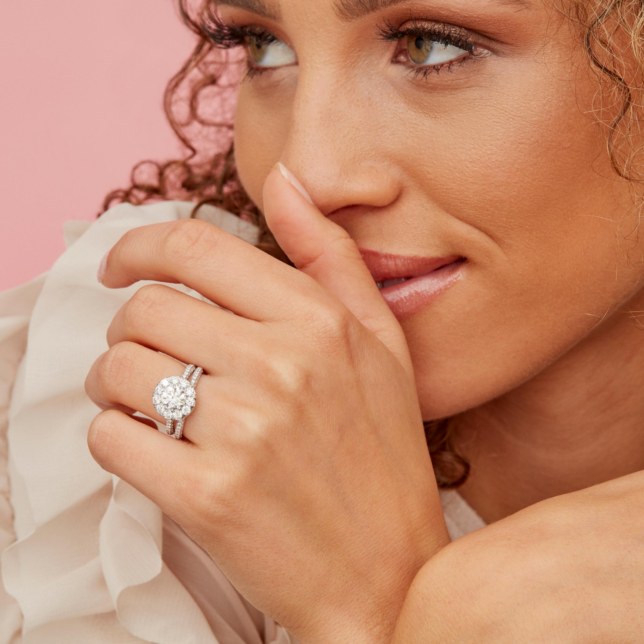 Jacqueline Round Brilliant Seamless Solitaire™ Engagement Ring with a diamond pavé band in Platinum Model Lifestyle by Oui by Jean Dousset
