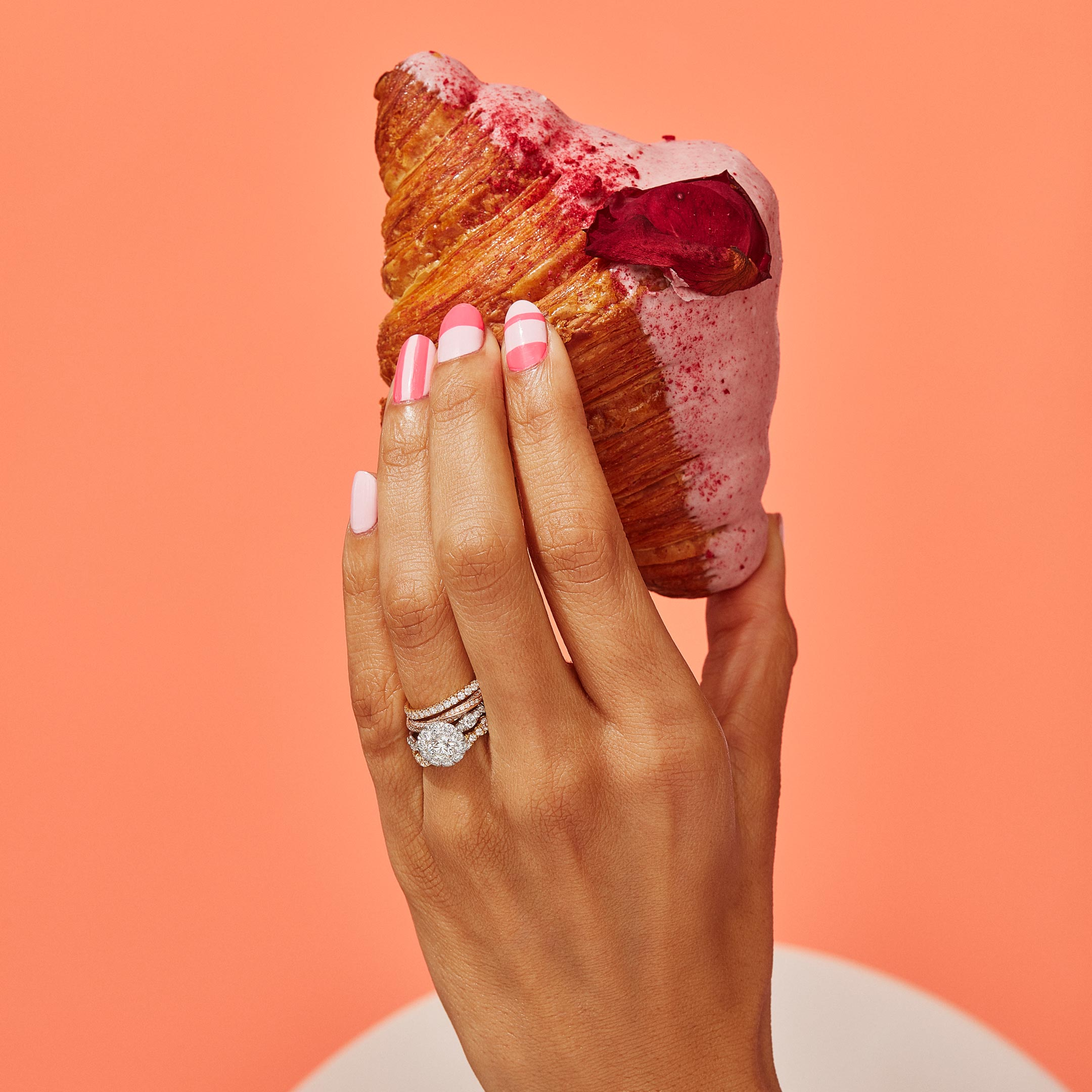 Yvonne Round Brilliant Seamless Solitaire™ Engagement Ring with a diamond pavé wave band in Platinum Hand with Pastry Lifestyle by Oui by Jean Dousset