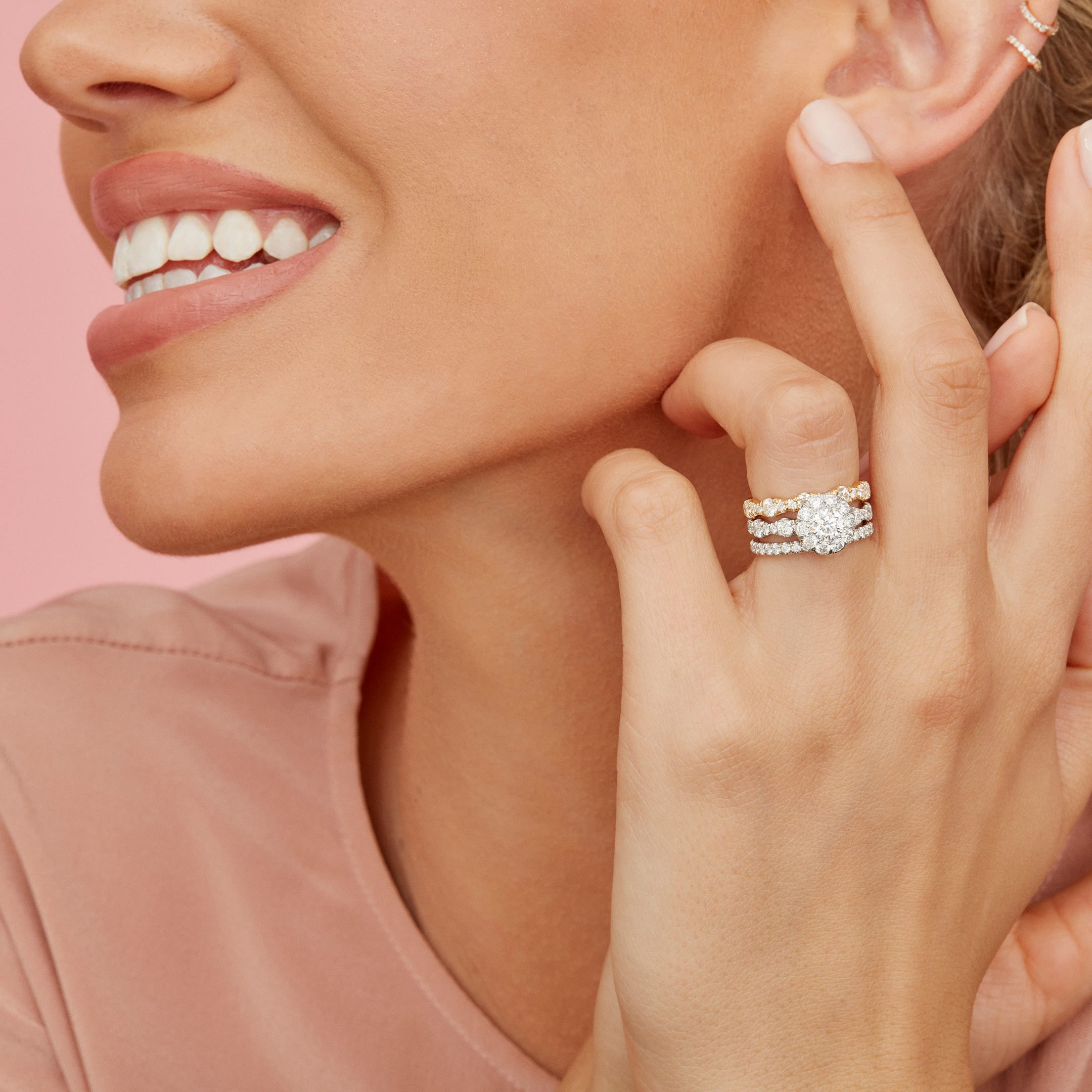 Yvonne Round Brilliant Seamless Solitaire™ Engagement Ring with a diamond pavé wave band in Platinum Hand Against Model Lifestyle by Oui by Jean Dousset