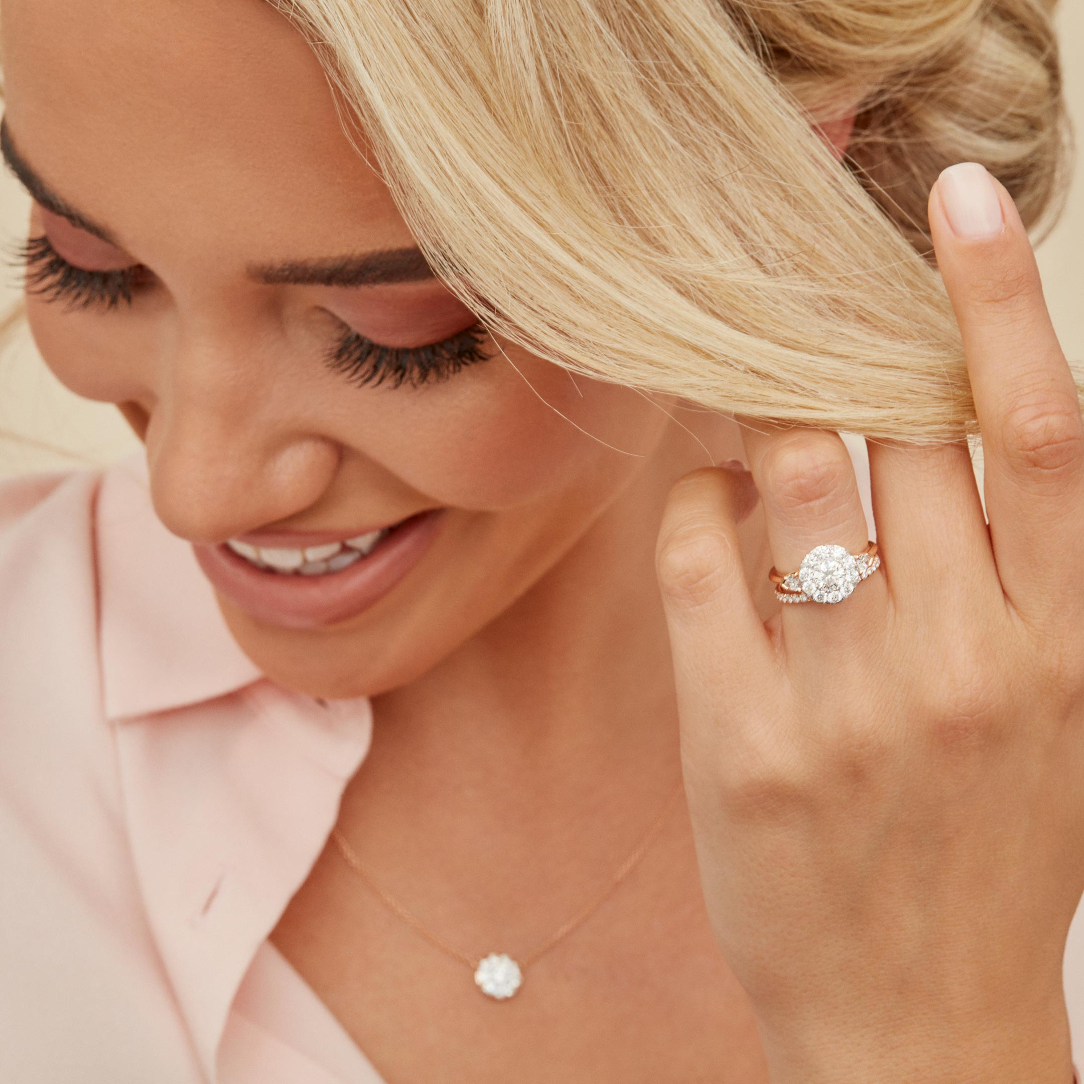 Clementine Round Brilliant Seamless Solitaire™ Three Stone Engagement Ring with pear-shaped side stones in 18k Rose Gold Model Lifestyle by Oui by Jean Dousset