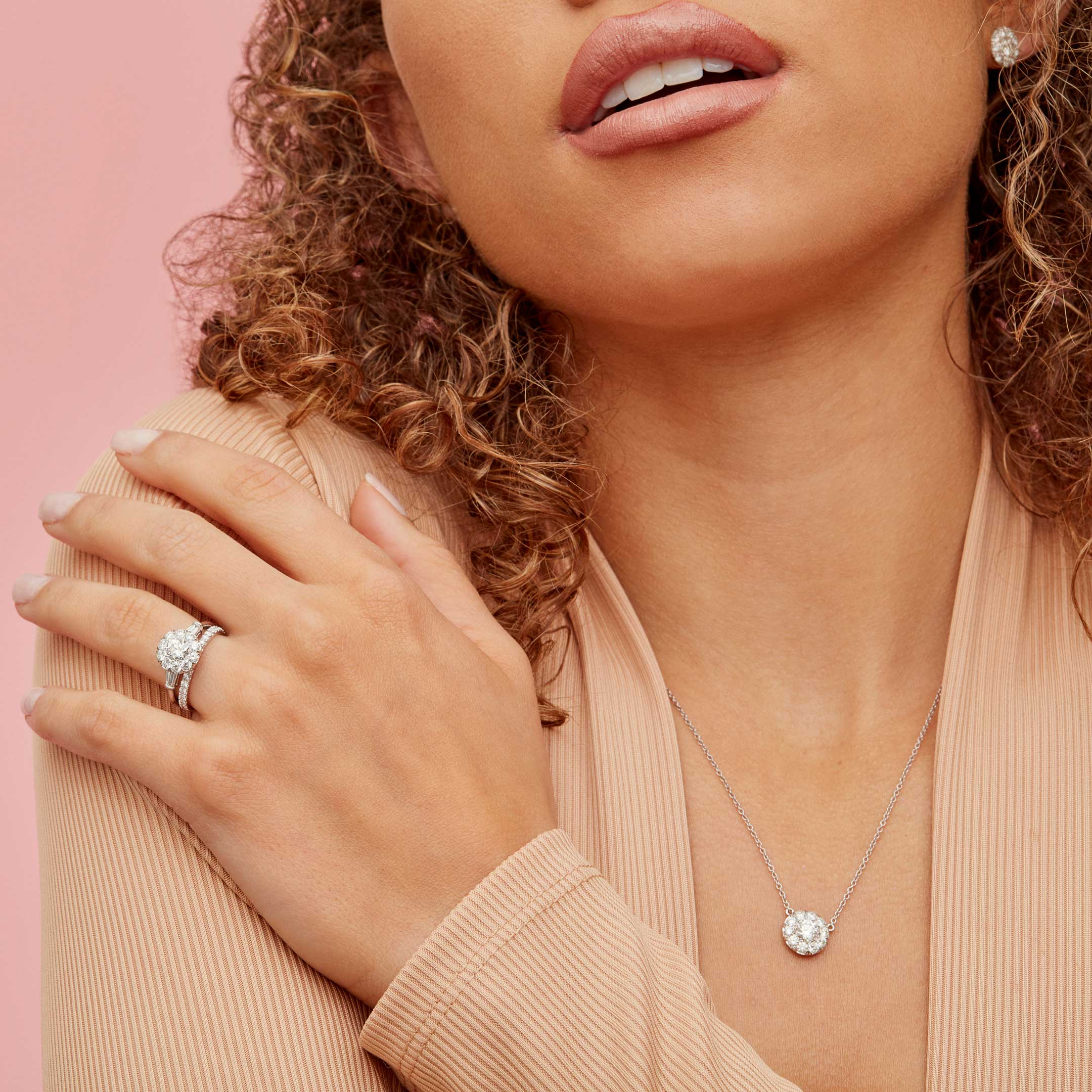 Lucile Round Brilliant Seamless Solitaire™ Diamond Pendant in Platinum Hand against Model Lifestyle by Oui by Jean Dousset