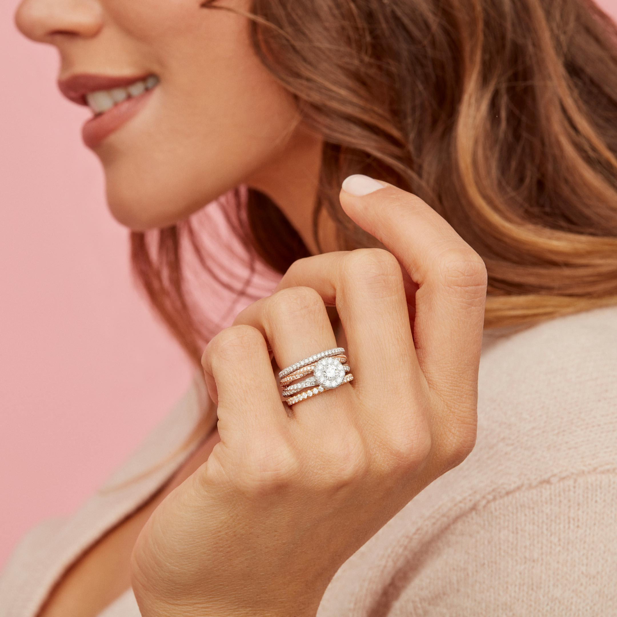 Camille Women's Wedding Band with twisted diamond pavé in 18k Rose Gold Hand against Model Lifestyle by Oui by Jean Dousset