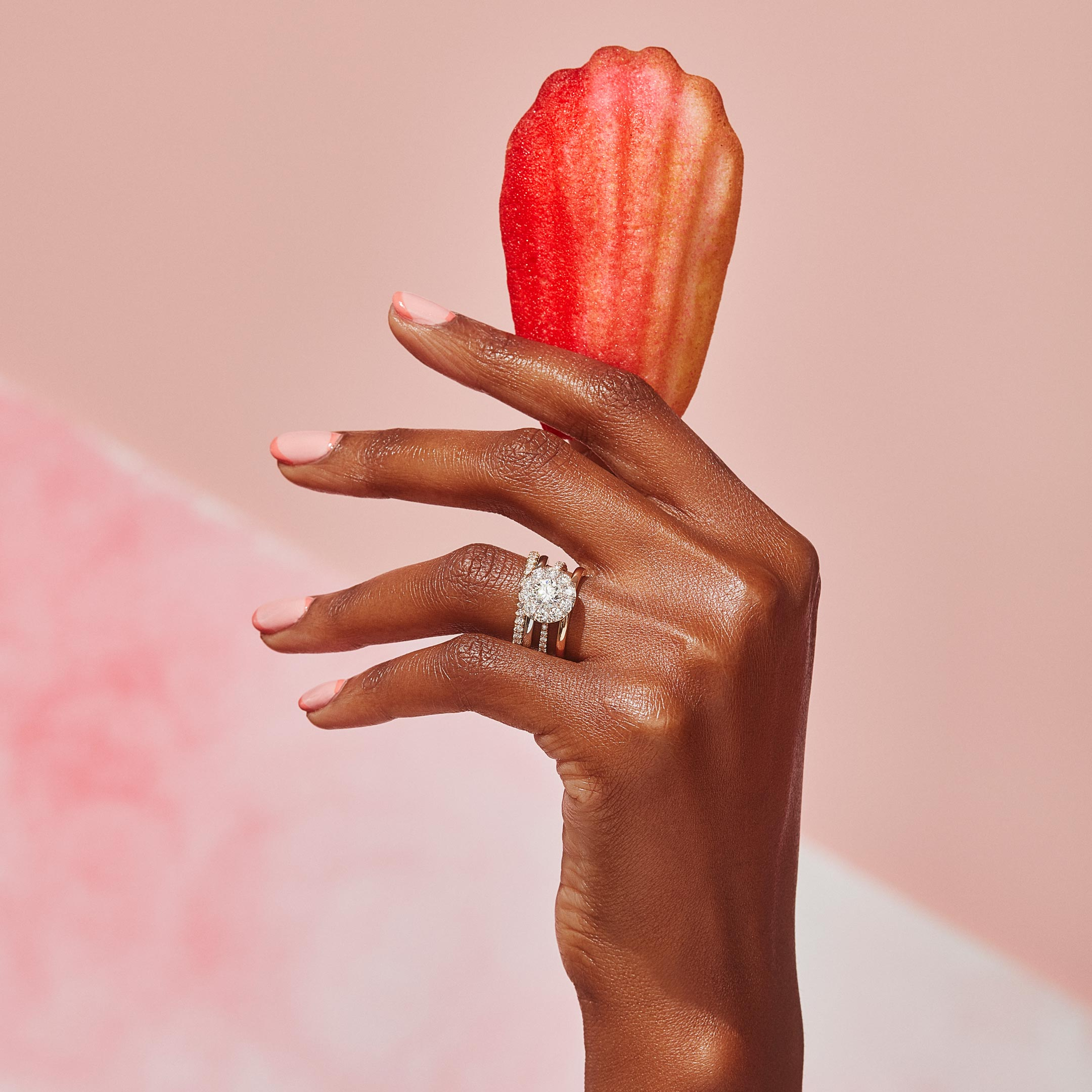 Eloise Round Brilliant Seamless Solitaire™ Engagement Ring with a diamond pavé band in 18k Rose Gold Hand with Cookie Lifestyle by Oui by Jean Dousset