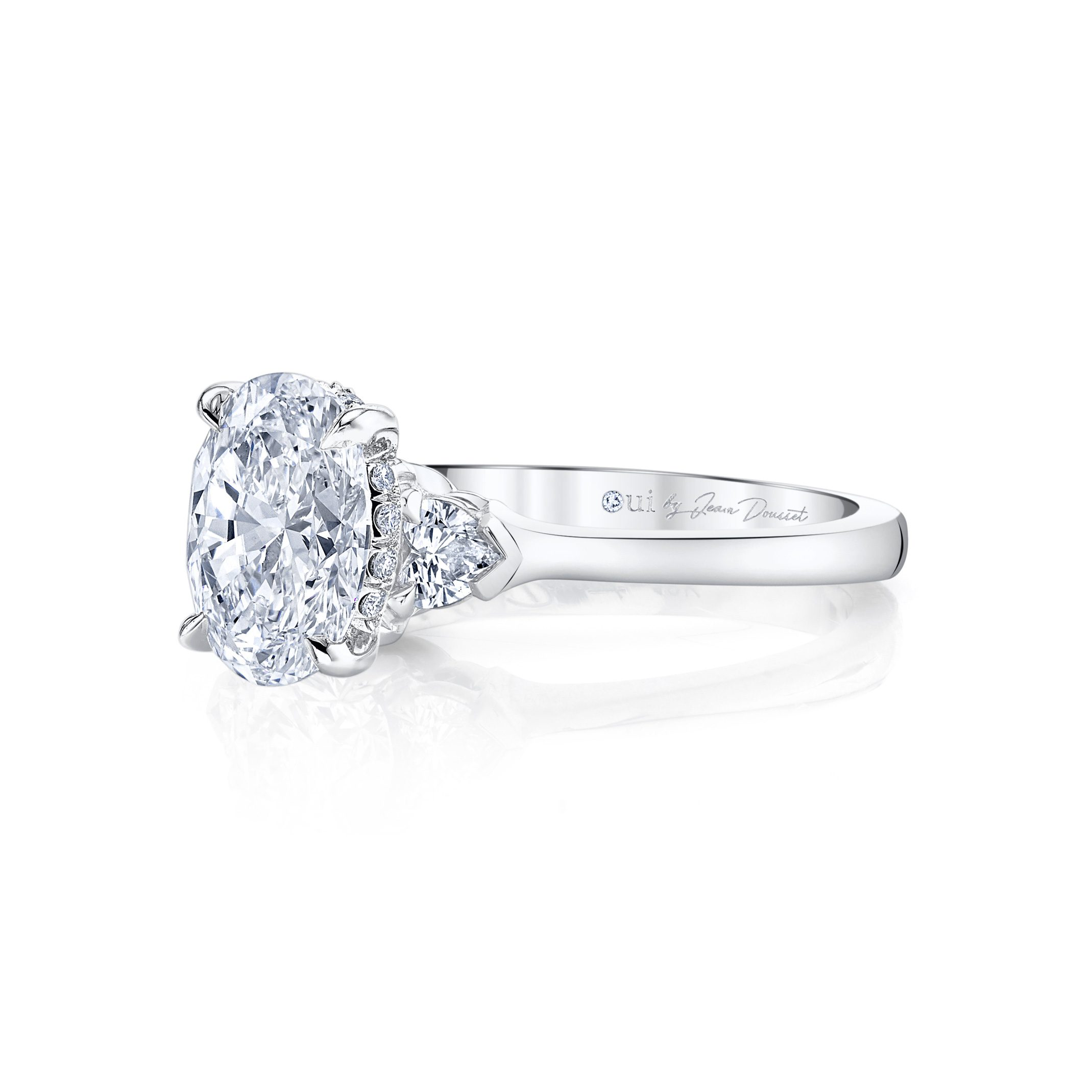 Claire Oval Three Stone Engagement Ring front shot with heart-shaped diamond side stones in 18k White Gold Side View by Oui by Jean Dousset