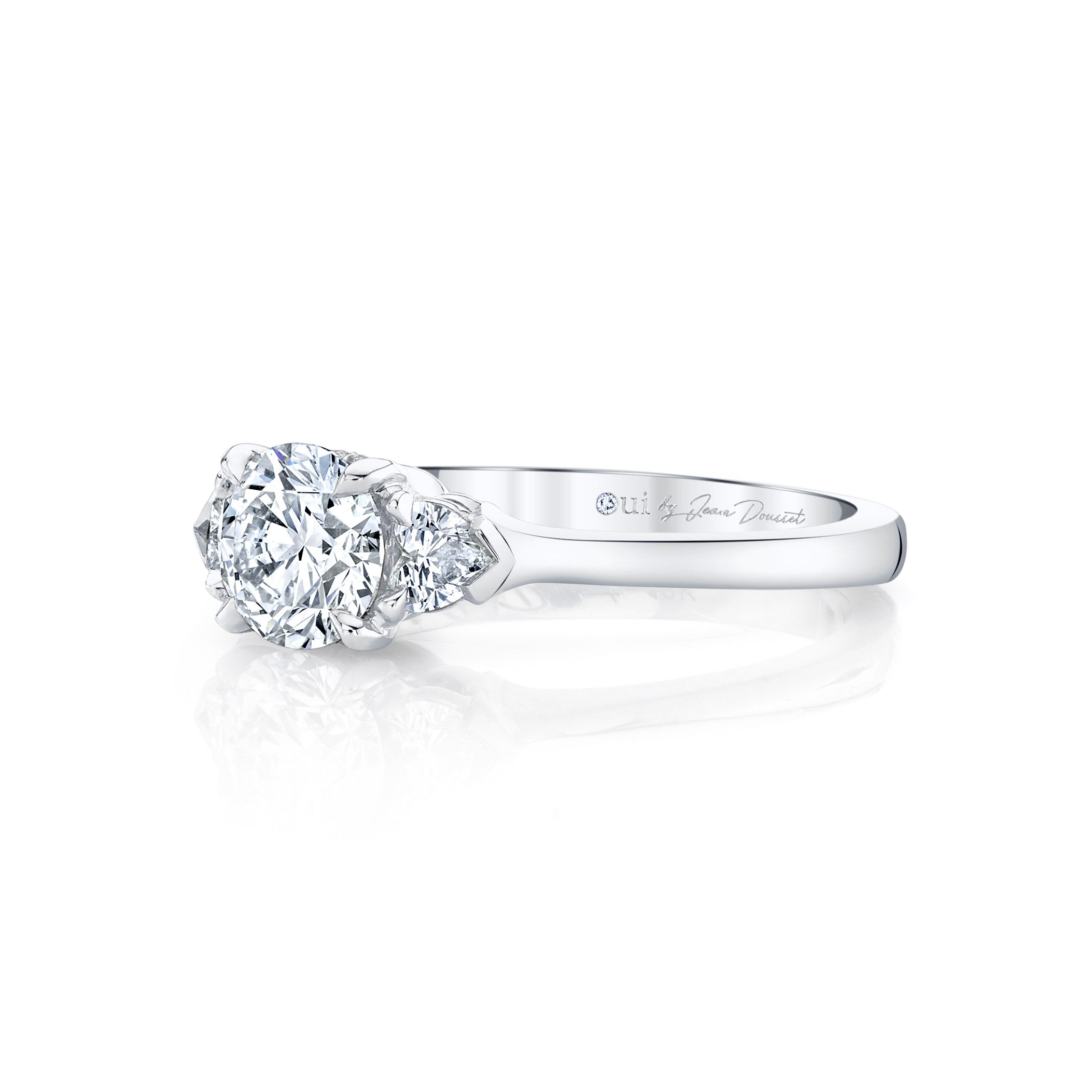 Claire Round Brilliant Three Stone Engagement Ring with heart-shaped diamond side stones in 18k White Gold Side View by Oui by Jean Dousset