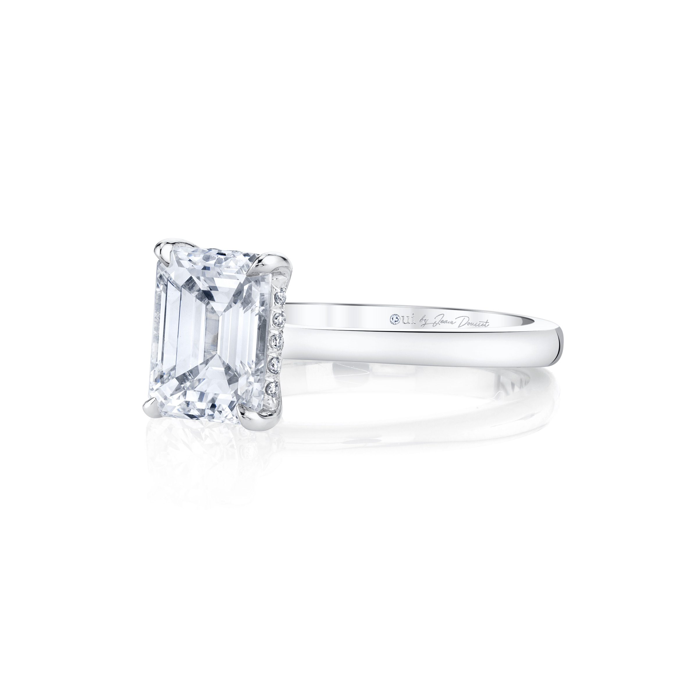 Colette Emerald Solitaire Engagement Ring with a sold band in 18k White Gold Side Shot by Oui by Jean Dousset