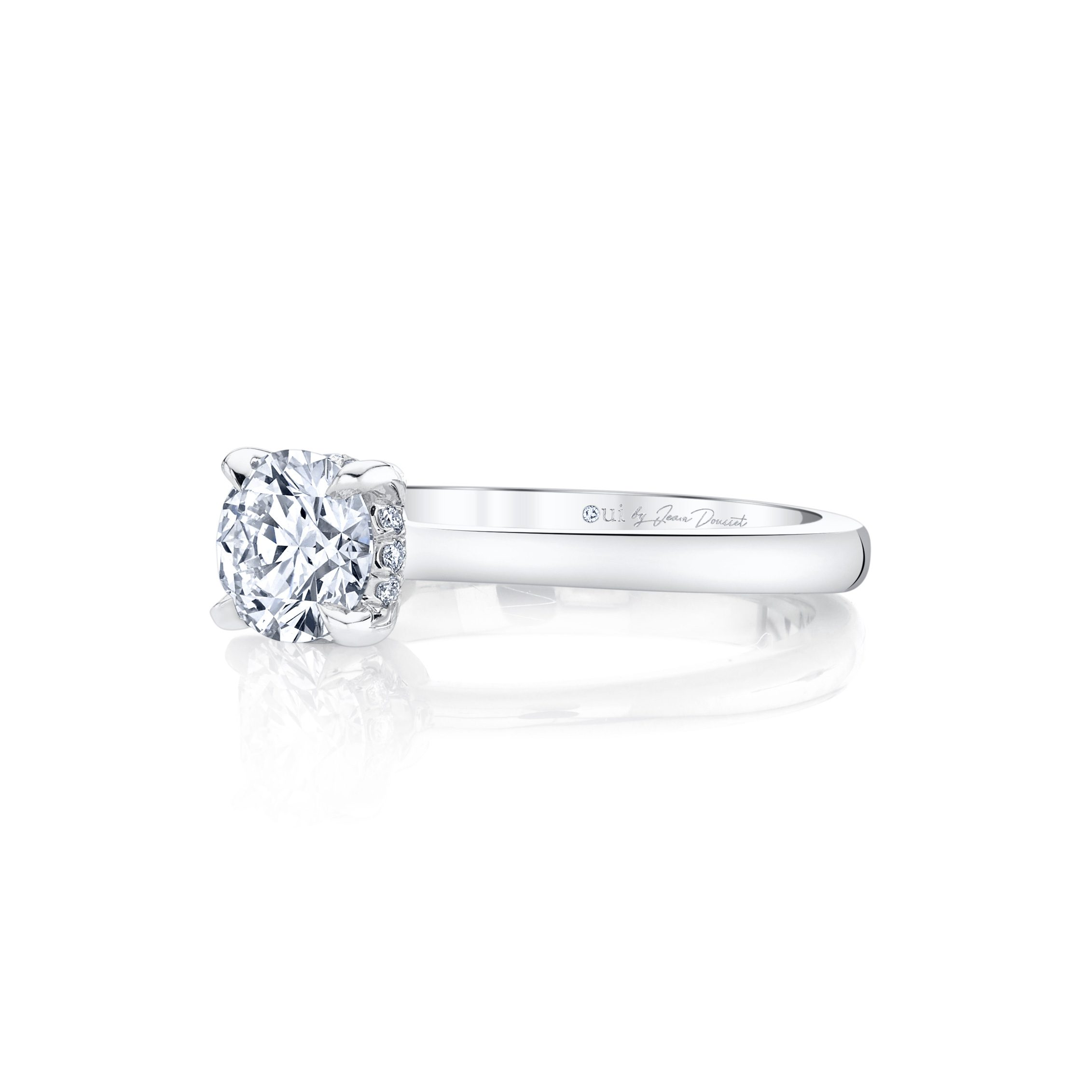 Colette Round Brilliant Solitaire Engagement Ring with a sold band in 18k White Gold Side View by Oui by Jean Dousset