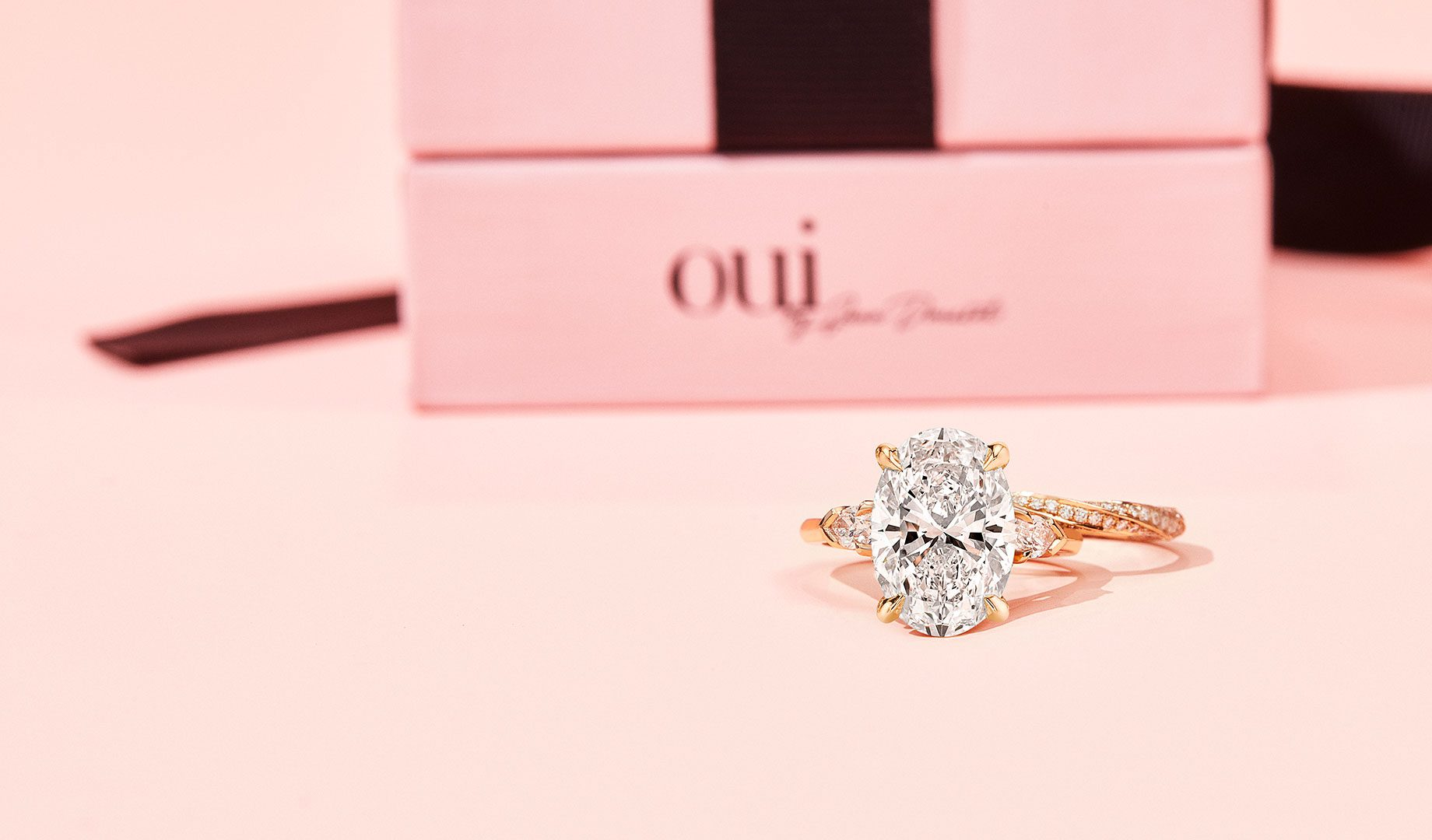 Claire Three Stone Lab Diamond Ring & Wedding Band on Pink Background