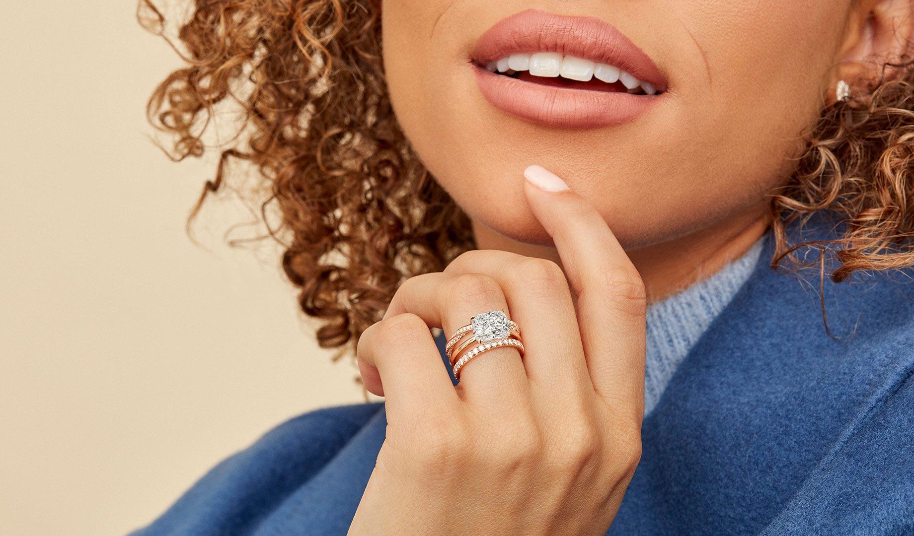 Oui Cushion Cut Engagement Ring on hand lifestyle image